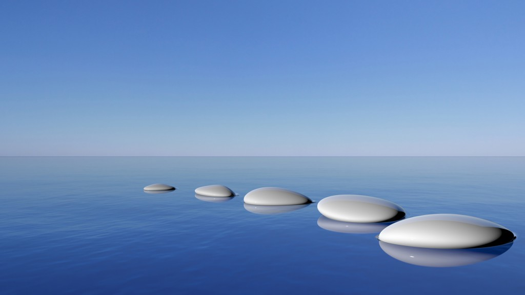 Zen stones in the blue water